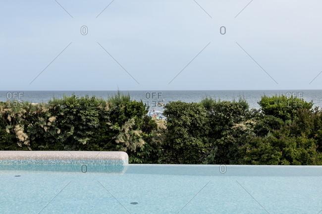 Venice, Italy - May 30, 2018: Infinity pool near the beach at Union Lido luxury resort in Punta Sabbioni