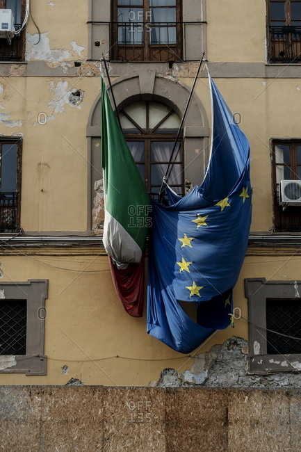 Palermo, Italy - October 20, 2018: Italian and European flags outside of building