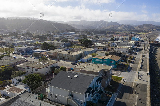 Aerial view of neighborhood and distant mountains in Pacifica California