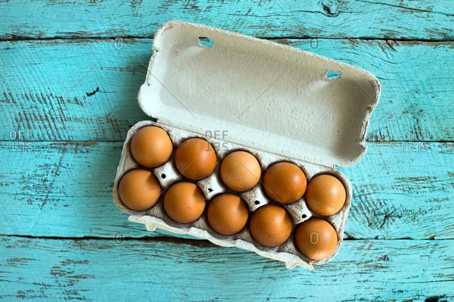 Overhead view of a fresh dozen of eggs