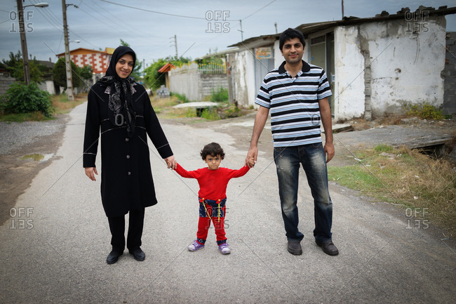 Muslim family holding hands on a walk