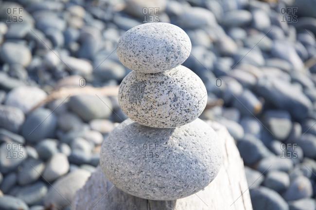 Three balancing rocks on beach