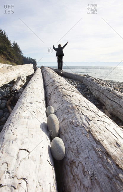 Tourist enjoying the view of the coastline on Vancouver Island