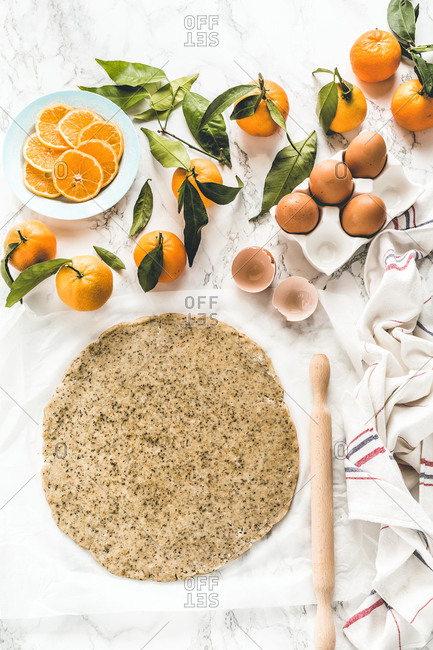 Raw dough and clementies to make a winter citrus galette