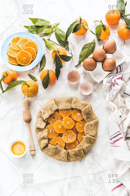 Clementine slices wrapped in raw dough to make a winter citrus galette
