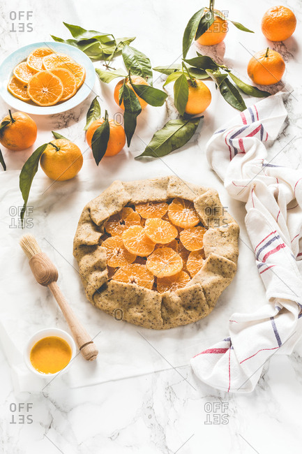 Winter citrus galette with clementine slices wrapped in raw dough