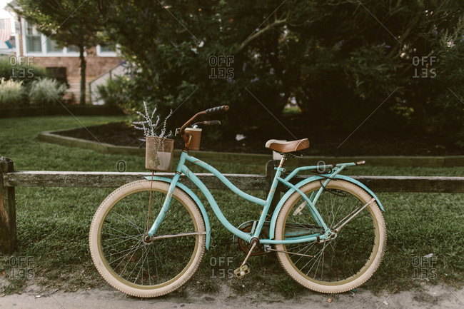Bike leaning on a wooden fence