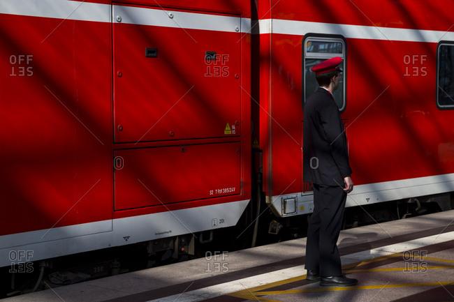 A railway worker at work in the main train station (Hauptbahnhof), Berlin, Germany.