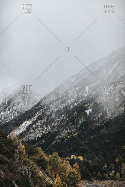 Snow falling on mountains
