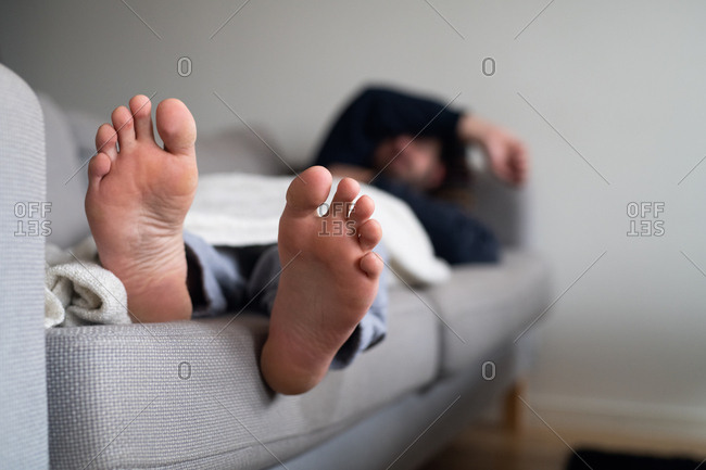 Sick man resting on couch