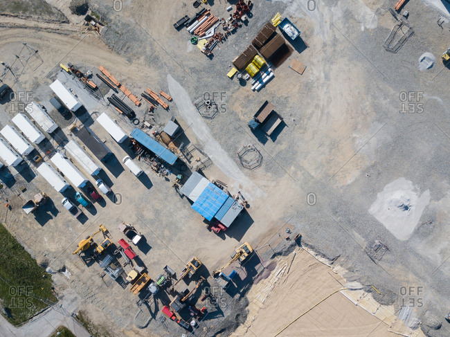 Aerial view of trucks and construction vehicles