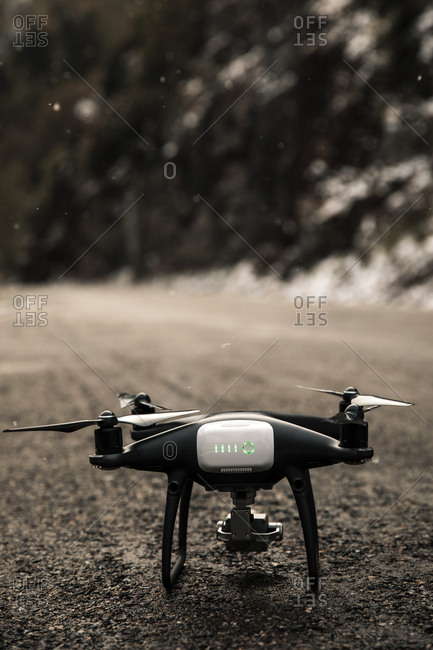 Photo of a drone on a road while snow