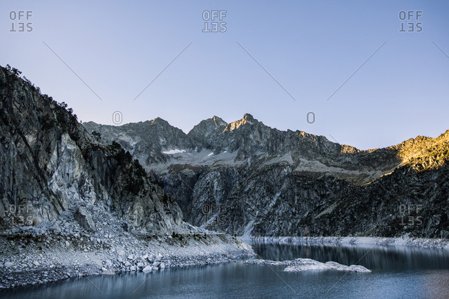 Mountains with a lake during sunset in winter