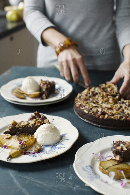 Chocolate cake made with olive oil, nuts and served with pears and vanilla ice cream