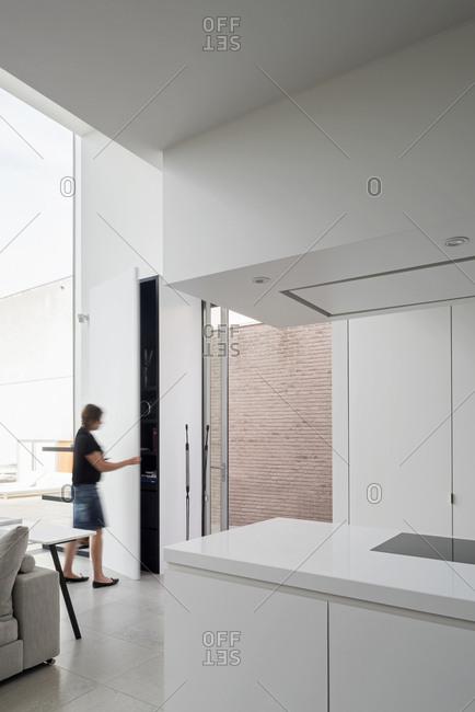 Woman opening door in a modern home