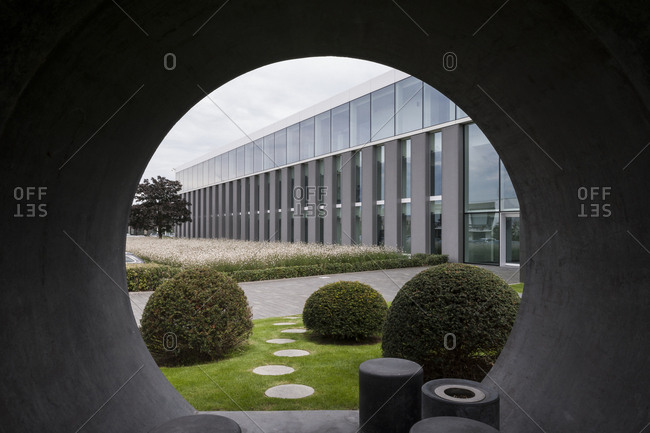 Gent, Belgium - August 18, 2015: View of office building through round opening