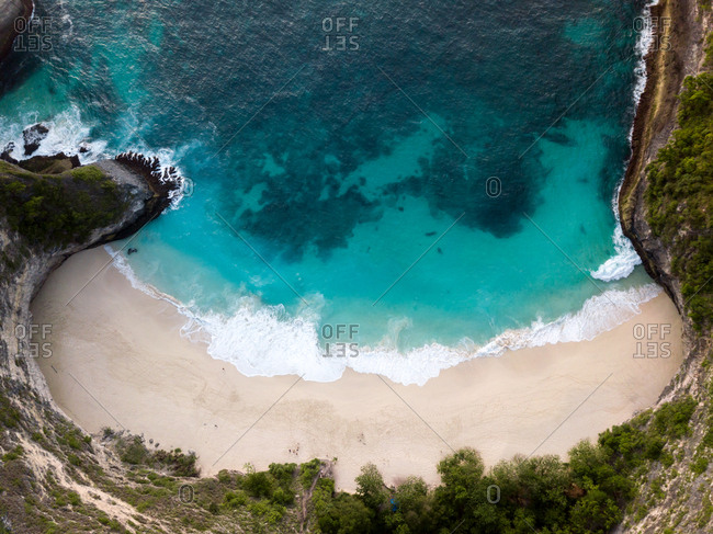 Aerial views of turquoise waters and a sandy beach