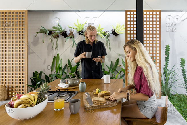 Couple having breakfast at the kitchen home