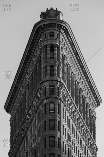New York City - USA - OCT 26 2015: The Flatiron Building, originally the Fuller Building, is a triangular 22-story, 285-foot  tall steel-framed landmarked building located at 175 Fifth Avenue in the borough of Manhattan, New York City, which is considered to be a groundbreaking skyscraper.