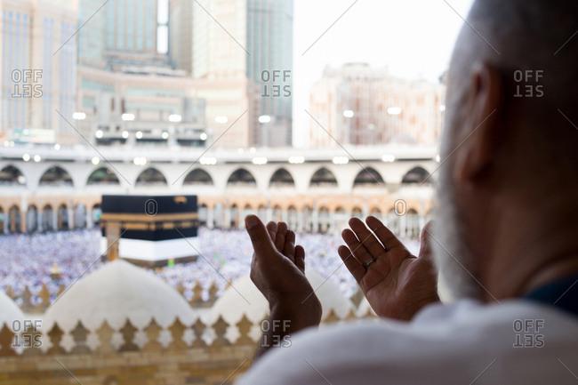 Mecca, Saudi Arabia - August 13, 2018: Muslim people are praying in Hajj