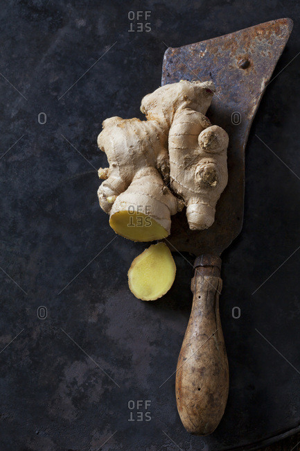 Sliced ginger root on an old knife