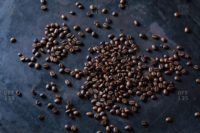 Freshly roasted coffee beans on dark background