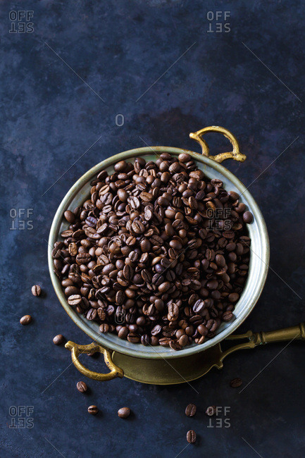 Freshly roasted coffee beans in a bowl