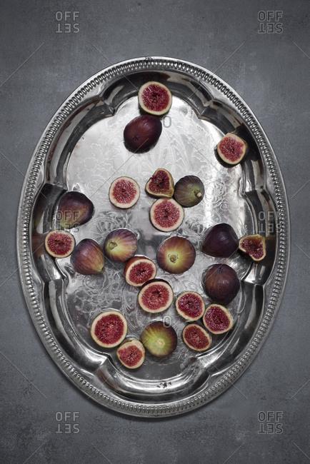 Fresh organic figs on silver tray