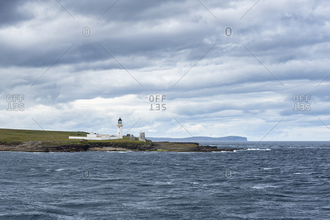 Great Britain- Scotland- Isle of Stroma- Lighthouse- Pentland Firth- Dunnet Head in the background
