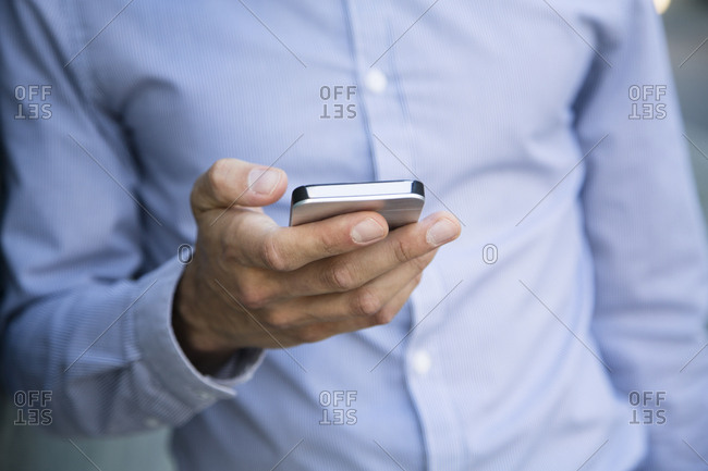 Close-up of businessman holding cell phone