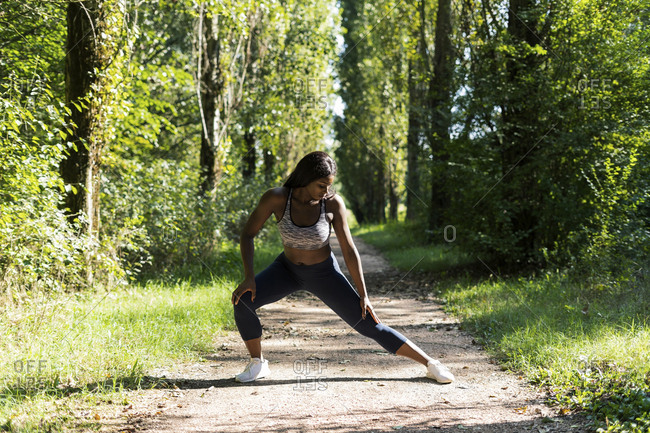 Female athlete warming up for workout in nature