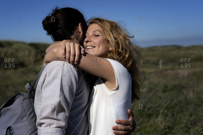 Happy young couple embracing affectionately