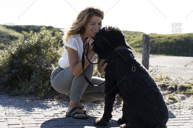Woman petting her dog