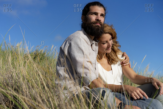 Young couple embracing in nature