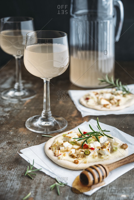 Tarte Flambee with apple- goat cheese- spring onions- rosemary and walnuts and Federweisser