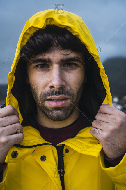 Norway- Lofoten- portrait of young man wearing a rain jacket