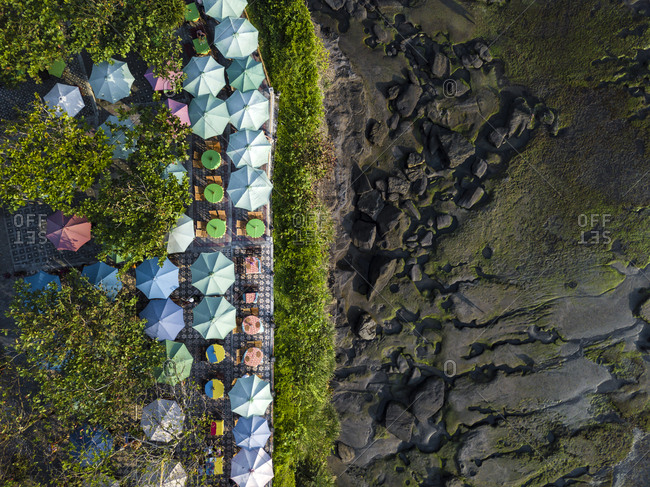 Indonesia- Bali- Aerial view of sunshades at Tanah Lot-temple