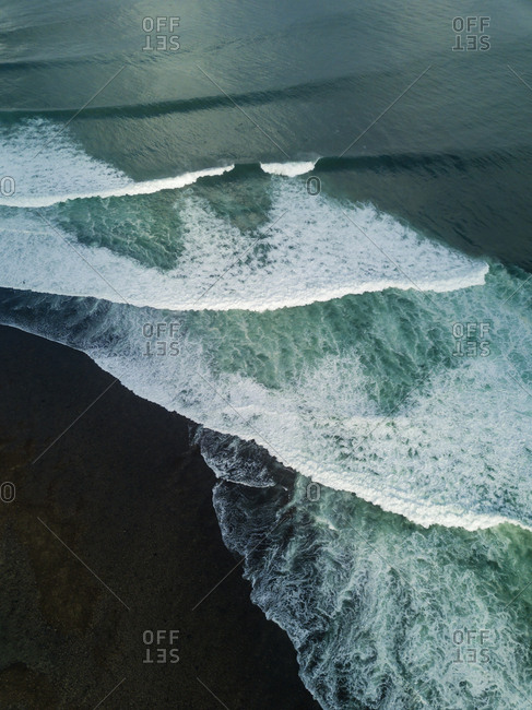 Indonesia- Bali- Aerial view of Uluwatu beach- breaking waves
