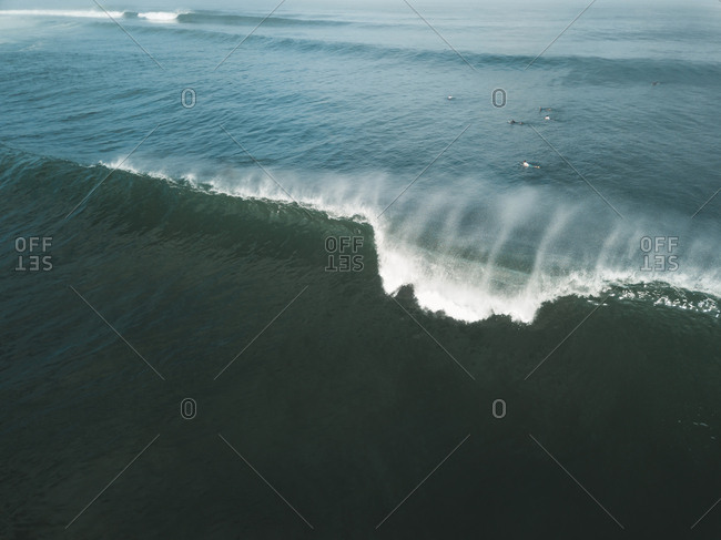 Indonesia- Bali- Aerial view of surfers- big wave