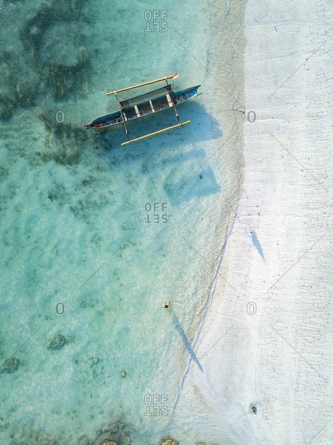 Indonesia- Lombok- Young woman at Tanjung Aan beach