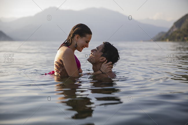 Happy affectionate young couple in a lake