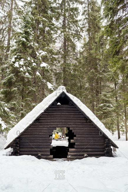 Finland- Kuopio- woman preparing campfire in winter