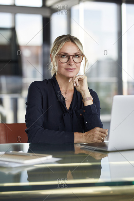 Businesswoman working in office- using laptop