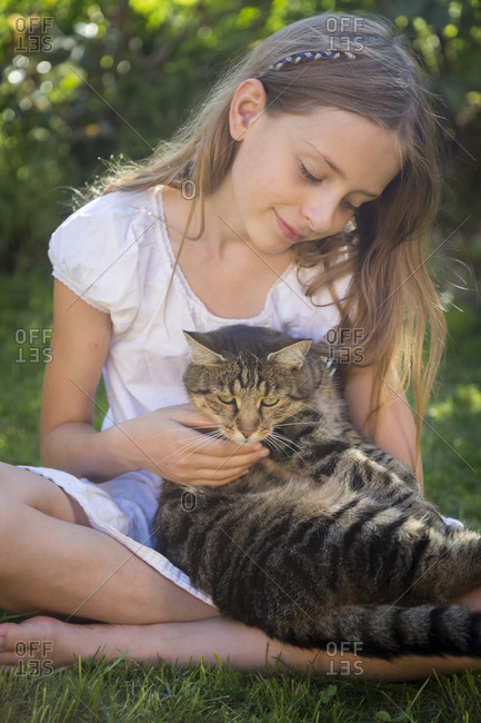 Girl with cat in garden