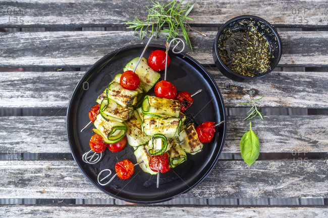 Grilled vegetarian grill skewers- tomato- sheep cheese and zucchini slices- rosemary garlic oil