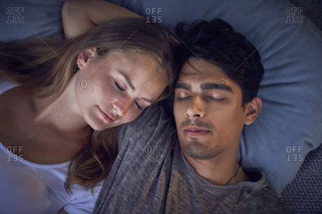 Young couple relaxing on cushions