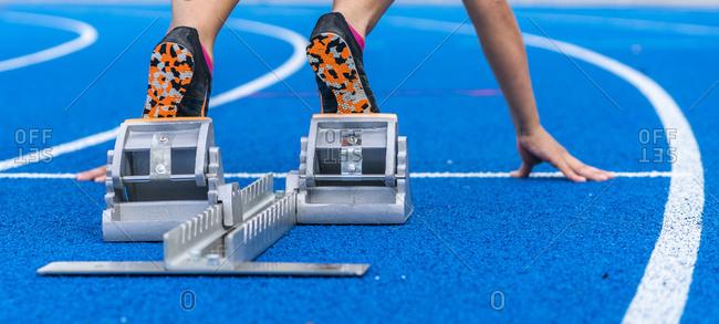 Detail of female runner in starting position