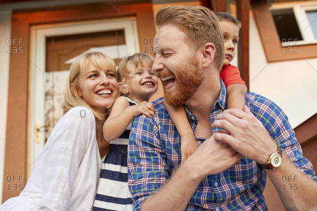 Happy family on porch of their home