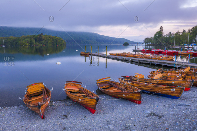 May 17, 2014: Rowing boats at Windermere at sunset, Lake District National Park, UNESCO World Heritage Site, Cumbria, England, United Kingdom, Europe