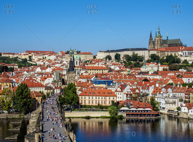 View over Vltava River and Charles Bridge towards Lesser Town and Castle, Prague, UNESCO World Heritage Site, Bohemia Region, Czech Republic, Europe